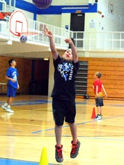Alfredo Parraz, 8, shoots a free throw Wednesday at the Cavemen basketball camp.