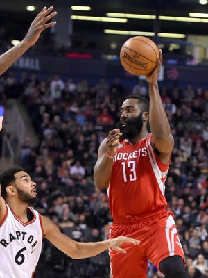 Houston Rockets guard James Harden (13) shoots for a basket over Toronto Raptors guard Cory Joseph (6) in the first half at Air Canada Centre.