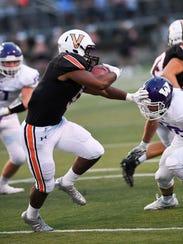 Waukee's Zach Eaton (18) tries to tackle Valley's Jevon