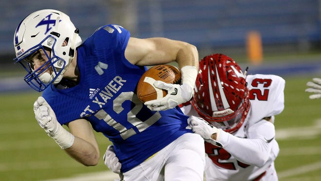 St. Xavier's Andrew Wittrock runs for a touchdown during the Bombers playoff game against Fairfield, Friday, Nov. 3, 2017.