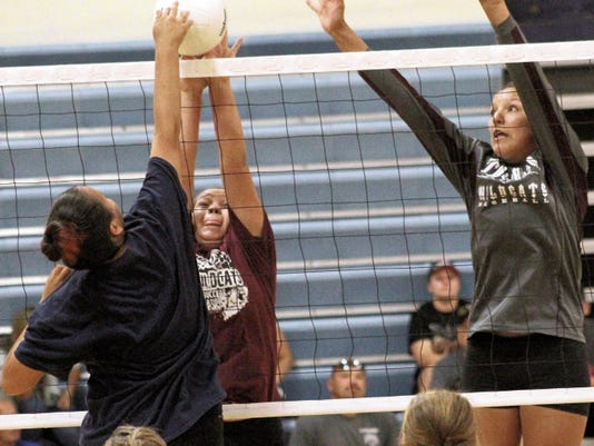 Cyan Fossum, left, and teammate Alex Veyna attempt to block a ball Tuesday at the Ruidoso High School gymnasium.