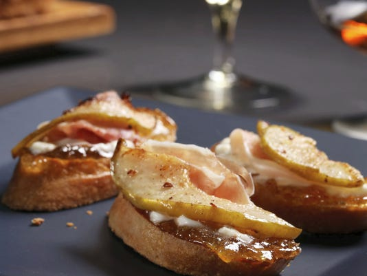 Creamy burrata is paired with prosciutto and gingered pear.