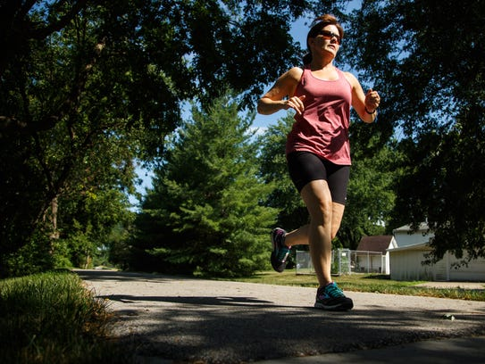 Beth Adams goes for a run in Indianola Wednesday, July