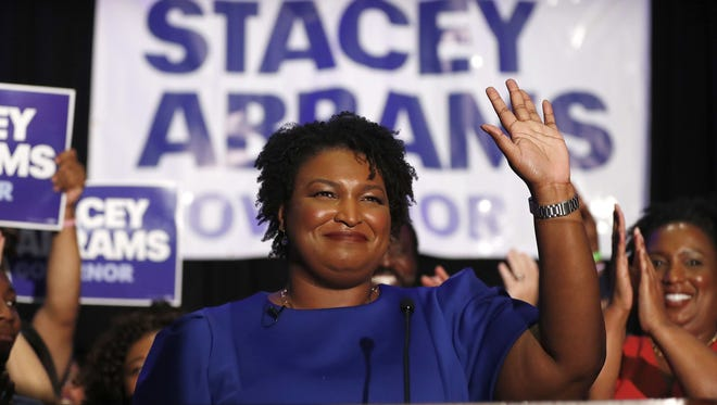 Georgia Democratic gubernatorial nominee Stacey Abrams takes the stage May 22, 2018, to declare victory in the primary on Election Night in Atlanta. If elected, Abrams would become the first African-American female governor in the nation.