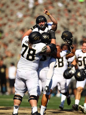 Southside High School graduate Mike Weaver (18) is lifted up by offensive lineman Tyler Hayworth (78) after hitting a 47-yard game-winning field goal as time expired Saturday as Wake Forest beat Army, 17-14, at Michie Stadium.