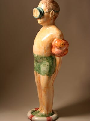 This terra cotta sculpture by Rose Siglin demonstrates how she uses children as images to tell a story.