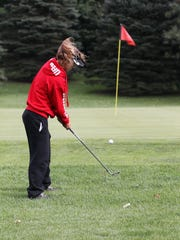 Sydney Leatherman, 16, from Harper Creek High School putts during the All City Golf Tournament at Binder Park Golf Course Friday afternoon.