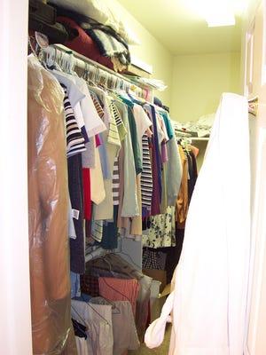 The closet before de-cluttering.