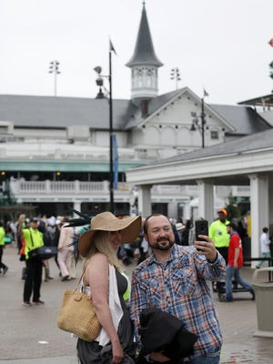Guests arrive at a wet and rainy Churchill Downs for the 144th running of The Kentucky Derby in Louisville, Kentucky. May 5, 2018
