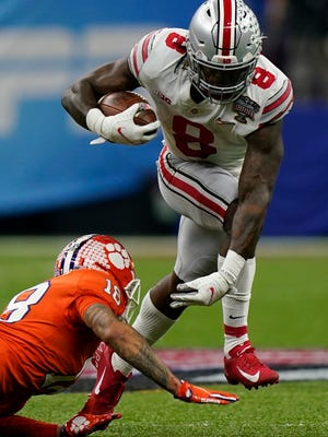 Ohio State running back Trey Sermon runs past Clemson safety Joseph Charleston during the first half of the Sugar Bowl NCAA college football game Friday, Jan. 1, 2021, in New Orleans. (AP Photo/Gerald Herbert)