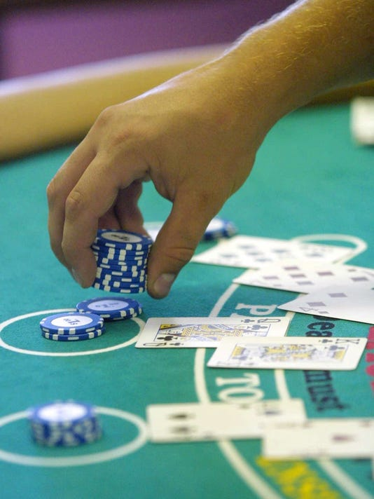 A future blackjack dealer lays out chips at the Mundus Institute Casino Training school in Mesa, Ariz., Monday, June 11, 2001. Since January, Gov. Jane Hull has been negotiating new gaming agreements with Arizona's 17 Indian tribes. One of the changes bein