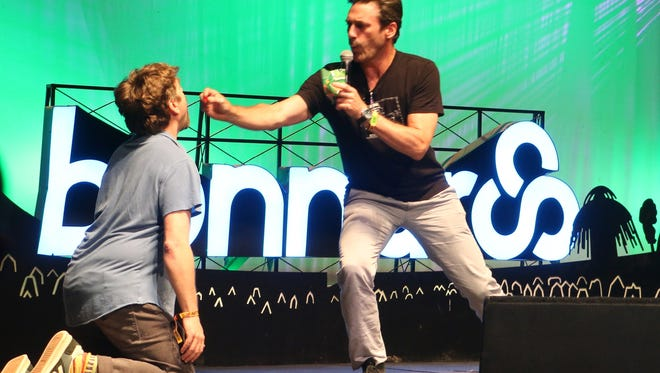 """Mad Men"" star Jon Hamm joined comedian Zach Galifianakis on stage for a bit during which Galifianakis was a dog and Hamm was his owner, feeding him treats."