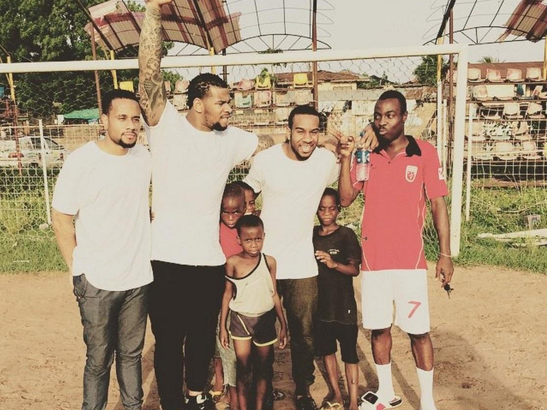 Robert Nkemdiche, second from left, and Denzel, second from right, pose with friends in Onitsha.