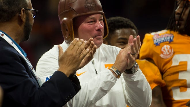 Tennessee head coach Butch Jones wears the Old Leather Helmet after winning the Chick-fil-A Kickoff Game at the Mercedes-Benz Stadium in Atlanta on Monday, Sept. 4, 2017.