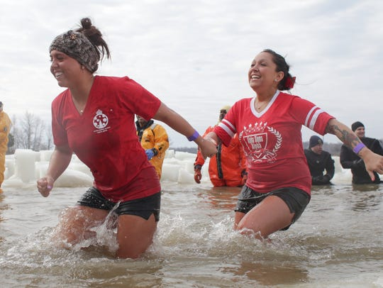 Participants get through the water at a Polar Plunge