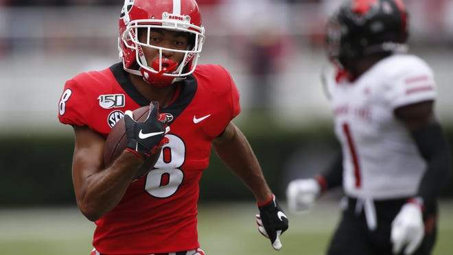 Georgia wide receiver Dominick Blaylock (8) runs in to score a touchdown in the first half of a NCAA football game between Georgia and Arkansas State in Athens, Ga., on Saturday, Sept. 14, 2019.