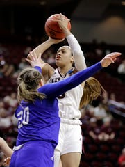 Texas A&M's Chennedy Carter (3) shoots as Drake's Maddy