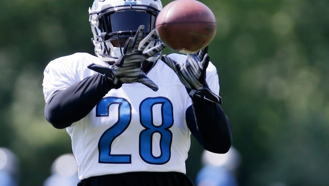 Detroit Lions cornerback Quandre Diggs (28) makes a catch during NFL football training camp Thursday, Aug. 4, 2016, in Allen Park, Mich. (AP Photo/Duane Burleson)