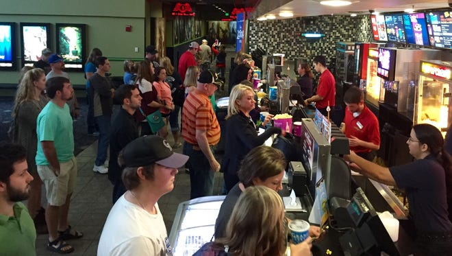 Movie-goers line up at the concessions stand  on Christmas day  at The Grand Theatre 18 in Hattiesburg.