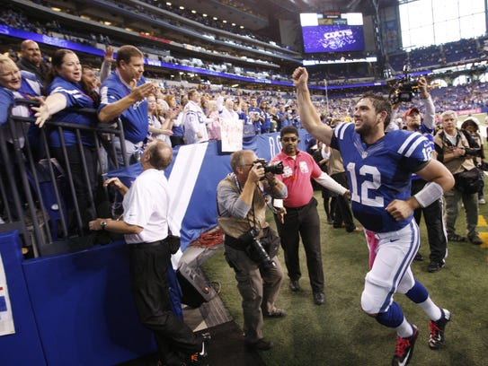 Colts quarterback Andrew Luck salutes fans after a