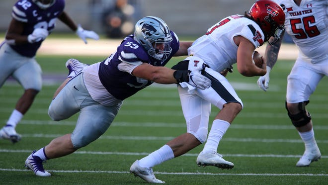 Kansas State defensive tackle Drew Wiley (59) tries to bring down Texas Tech quarterback Henry Colombi (3) during an Oct. 3 game at Bill Snyder Family Stadium. Wiley leads the Wildcats in sacks and tackles for loss.