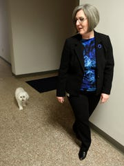 Buddy follows Laurie around the halls of the Milford Police Department on Feb. 3.