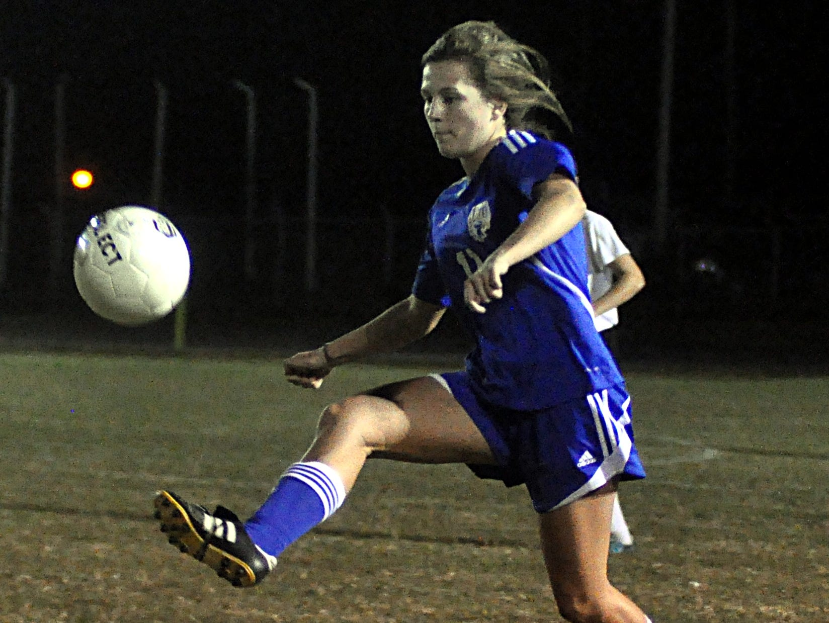 Merrol Hyde Magnet freshman Abbey Miller gains possession of the ball during first-half action.