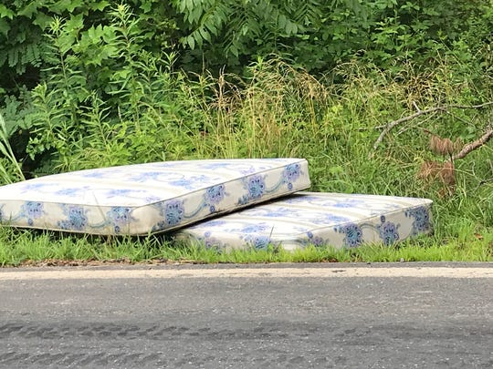 Someone discarded these old mattresses on Pond Road