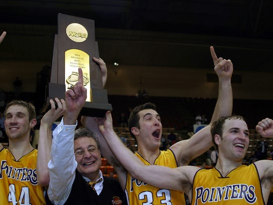 Players celebrate with Coach Jack Bennett after UWSP's