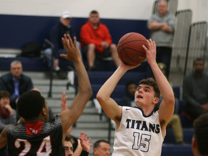 Webster Thomas' Andrew Mason shoots over Penfield's