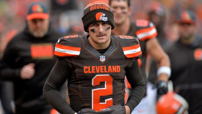 Cleveland Browns quarterback Johnny Manziel walks off the field at halftime of a game against the Cincinnati Bengals.