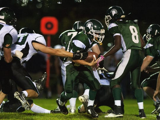 Brandon Bigelow (24) and the Winooski High School football team continue to right with declining numbers.