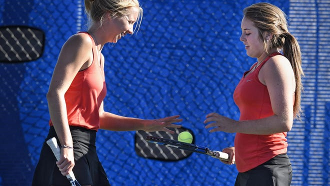 Rebekah Zwiener and Anne Bowe talk before the start of their tennis match Thursday at South Junior High School.