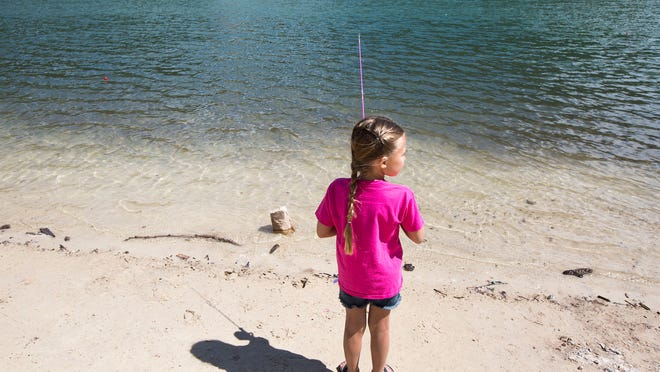 Isabella Chambers, 6, fishes in the cold waters with her pink fishing rod on a sunny day at Tibble Fork Reservoir on Thursday, June 15, 2017.