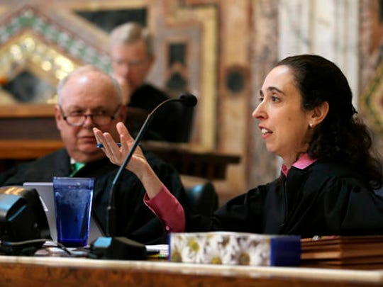 FILE - In this Sept. 18, 2014, file photo, Circuit Judge Michelle T. Friedland, right, gestures while questioning Barry Bonds' attorney, Dennis Riordan, before an 11-judge panel of the 9th U.S. Circuit Court of Appeals in San Francisco. Friedland is one of three judges on the San Francisco-based 9th Circuit Court of Appeals deciding whether to reinstate President Donald Trump's travel ban.
