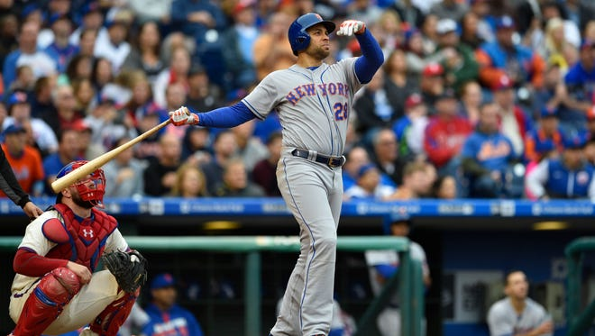 New York Mets first baseman James Loney (28) watches the ball after hitting a two-run home run during the sixth inning against the Philadelphia Phillies at Citizens Bank Park.