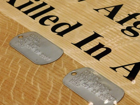 Dog tags representing the last two county residents killed in action in Iraq, Lance Cpl. Jeremy Shock and Staff Sgt. Jonathan Martin, are among those installed in the VFW's new bar.