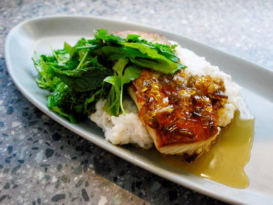Pan-seared mahi over coconut rice grits with serrano