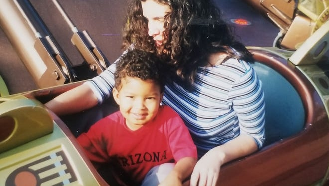 Amy Porterfield on a ride at Disneyland with her son, Jordan, when he was a child.