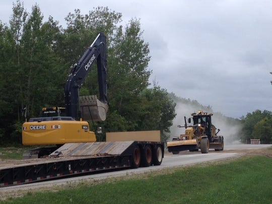 Door County Highway Department crew repairs County B where an abandoned mining tunnel collapsed under the road Thursday.