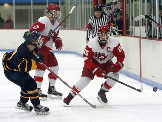 Dylan Cox chips the puck in deep during a game against