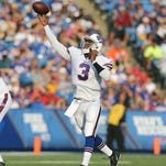 Bills QB EJ Manuel is all smiles as he runs to congratulate receiver Tobias Palmer who caught a 37-yard touchdown pass.