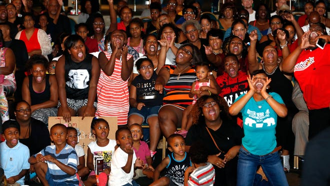 Family and friends cheer on Linkin Bridge at Louisville's America's Got Talent finale watch party. Sept. 14 2016