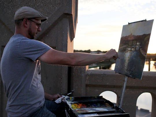 Jason Sacran of Fort Smith, Arkansas paints the scenery