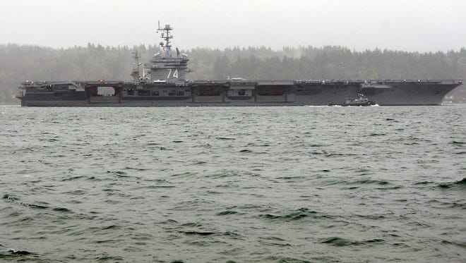 The USS John C. Stennis sails through the heavy rain past Bachmann Park as it heads for Naval Base Kitsap Bremerton on Monday, Jan. 29, 2018.