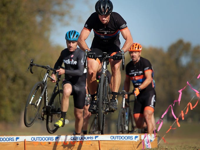 The leaders in the A Race clear a course barrier during