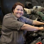 Nicole Porter, 26, pauses April 2 while replacing an alternator on a Volvo semi tractor-trailer. Porter is a few classes away from receiving the highest level of certification for Volvo mechanics and is on pace to become the first female master technician for Volvo Trucks.