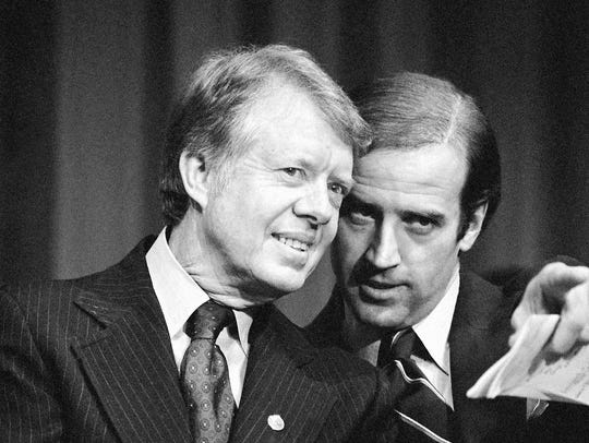 President Jimmy Carter listens to then-Sen. Joe Biden