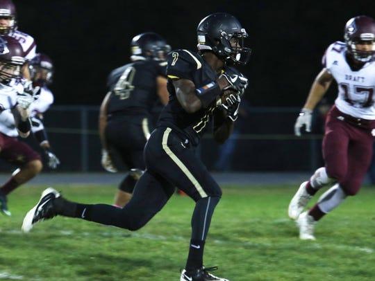 Buffalo Gap's Dylan Thompson runs the ball during the