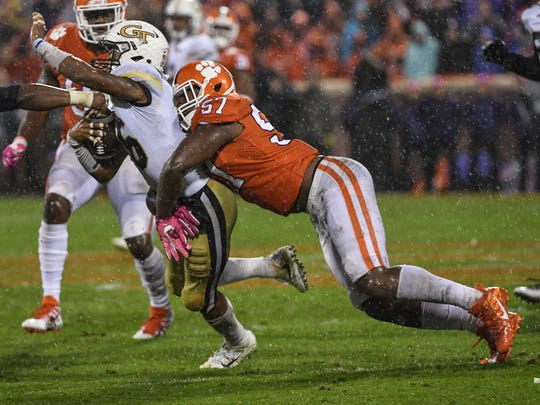 Clemson linebacker Tre Lamar (57) sacks Georgia Tech quarterback TaQuon Marshall(16) during the second quarter in Memorial Stadium at Clemson on Saturday.